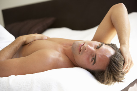 ragazze bionde: Young Man Relaxing On Bed  Archivio Fotografico