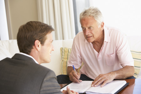 financial advisor: Senior Man Meeting With Financial Advisor At Home Stock Photo