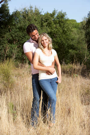 couples outdoors: Young Couple Walking Through Summer Countryside