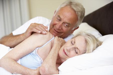 sleepwear: Senior Woman In Bed With Amorous  Husband