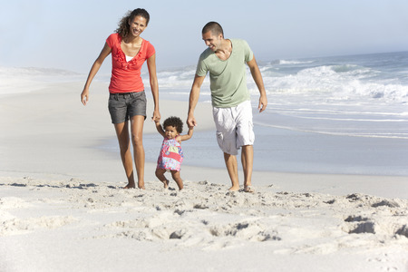 beaches: Family Having Fun On Beach Stock Photo