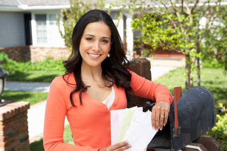 Worried Hispanic Woman Checking Mailbox