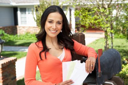 Worried Hispanic Woman Checking Mailbox