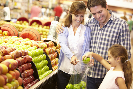 family budget: Family buying fruit in supermarket Stock Photo