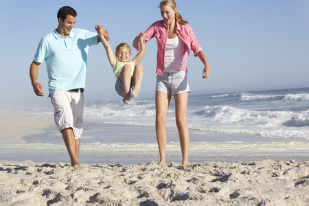 Family Having Fun On Beach Stock Photo