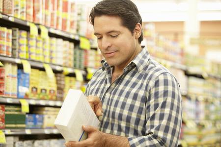Man shopping in supermarket photo