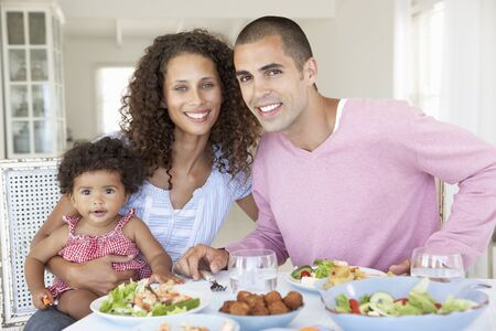 mealtime: Family Enjoying Meal Together At Home Stock Photo