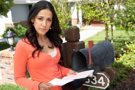 mailbox: Hispanic Woman Checking Mailbox