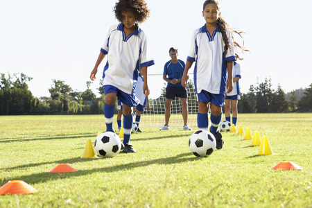 six girl: Group Of Children In Soccer Team Having Training With Coach
