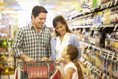 woman shopping cart: Family shopping in supermarket