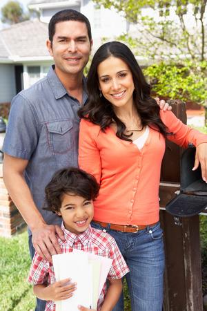 Hispanic Family Checking Mailbox