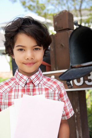 checking: Hispanic Boy Checking Mailbox Stock Photo