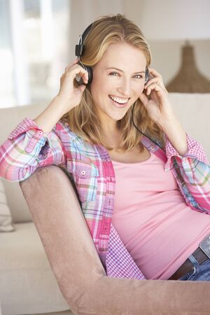 relaxing at home: Young Woman Relaxing Listening To Music At Home
