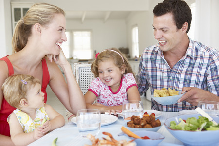 5 10 year old girl: Family Enjoying Meal Together At Home Stock Photo