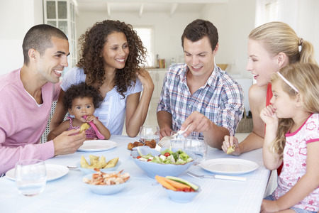 5 10 year old girl: Families Enjoying Meal Together At Home