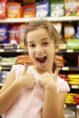 confectionery: Girl in confectionery supermarket confectionery aisle