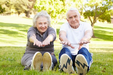 stretching: Senior couple exercising