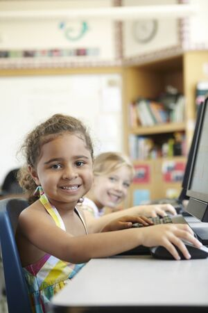 45 years old: Elementary School Pupil In Computer Class Stock Photo