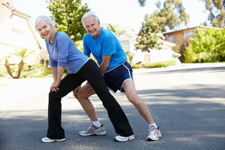 Elderly man and younger woman jogging photo
