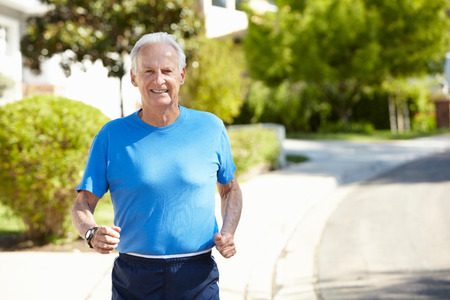 running late: Elderly man jogging