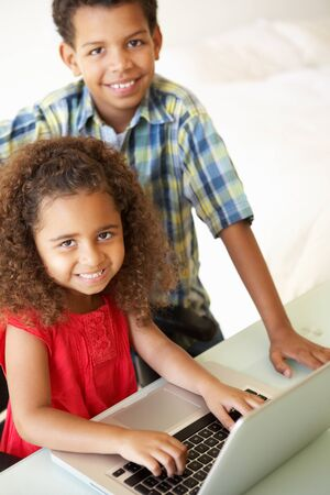 5 10 year old girl: Children Using Laptop At Home