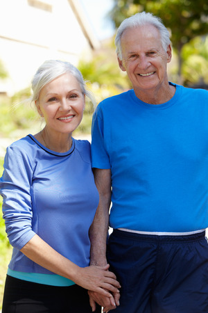 Elderly man and younger woman outdoors Stock Photo