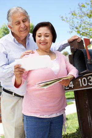 mail man: Senior Hispanic Couple Checking Mailbox