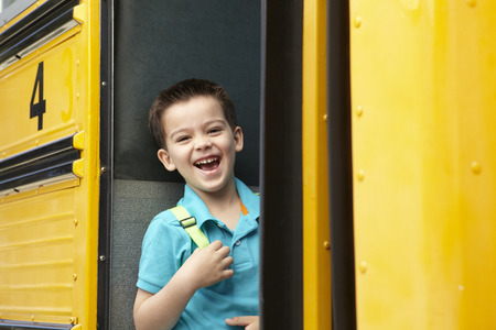 old school: Elementary School Pupil Boarding Bus Stock Photo