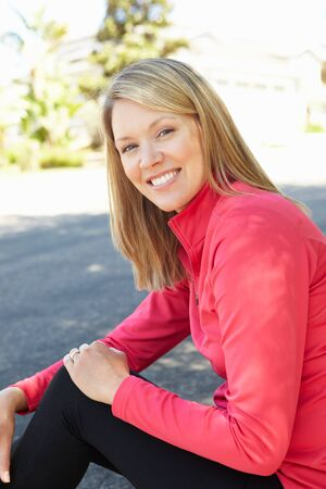 kerb: Fit, active woman outdoors