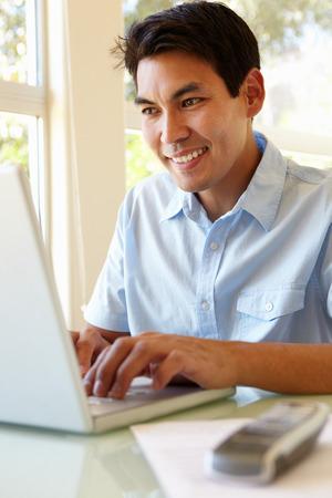 filipino adult: Filipino man working on laptop