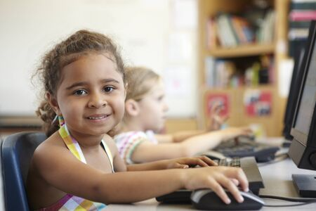 five years old: Elementary School Pupil In Computer Class Stock Photo