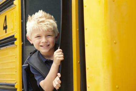 school year: Elementary School Pupil Boarding Bus Stock Photo
