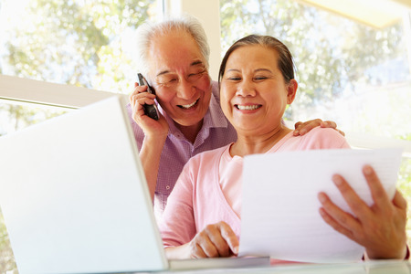 Senior Taiwanese couple working at home