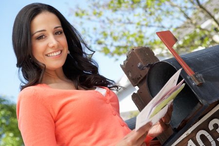 checking: Hispanic Woman Checking Mailbox