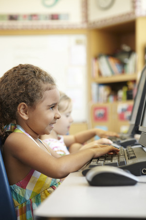 the pupil: Elementary School Pupil In Computer Class Stock Photo