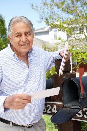 Senior Hispanic Man Checking Mailbox