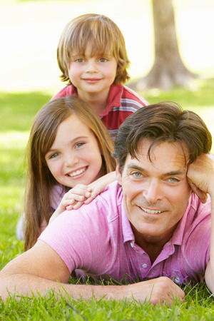 Father with with children outdoors photo