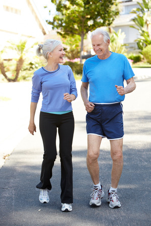 Elderly man and younger woman jogging Stock Photo - 41512116