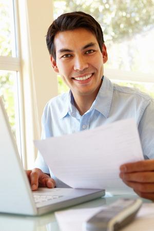 filipino adult: Filipino man working at home