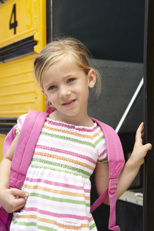 and four of the year: Elementary School Pupil Boarding Bus Stock Photo