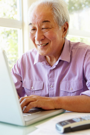 taiwanese: Senior Taiwanese man working on laptop