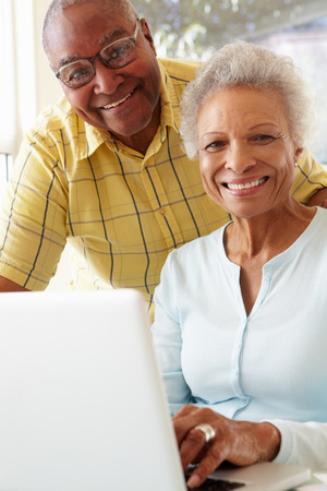 Senior Couple Using Laptop At Home photo