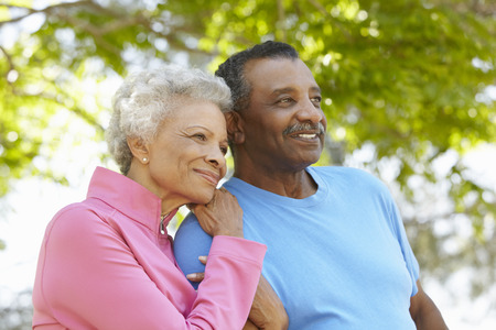 Portrait Of Senior African American Couple Wearing Running Clothing In Park