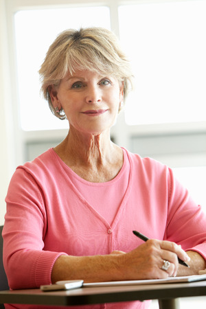 coursework: Mature student in class Stock Photo