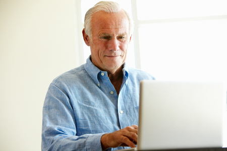 coursework: Mature student using computer in class Stock Photo