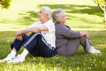 ground: Senior couple resting after exercise