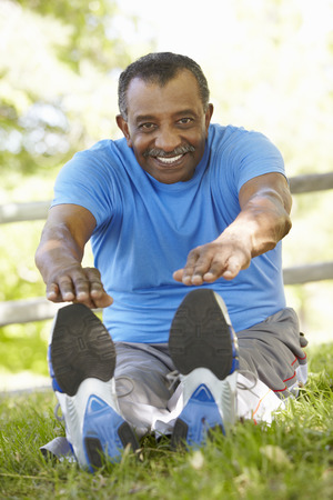 senior african: Senior African American Man Exercising In Park