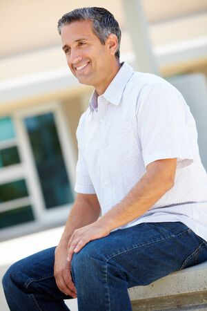 greying: Portrait man sitting outdoors