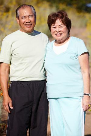 asian adult: Senior couple outdoors Stock Photo