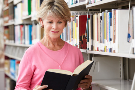 one senior: Mature student in library Stock Photo